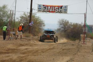 Phil Blurton and Beau Judge crossing the finish line at the ndc utv pro race