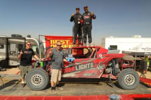 randy raschein and team on podium after winning utv unlimited class at the bitd bluewater desert challenge off-road race