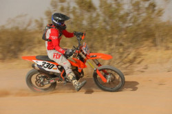 Expert Motorcycle Open racer competing in a bitd off-road race