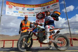 Brandon Krause on podium after winning 2021 world hare and hound championship